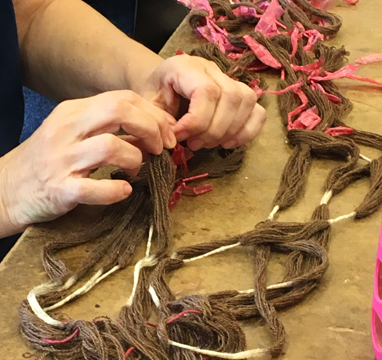 Dorina untying her ikat warp after dyeing it in black walnut. I believe it was also destined for the indigo pot.