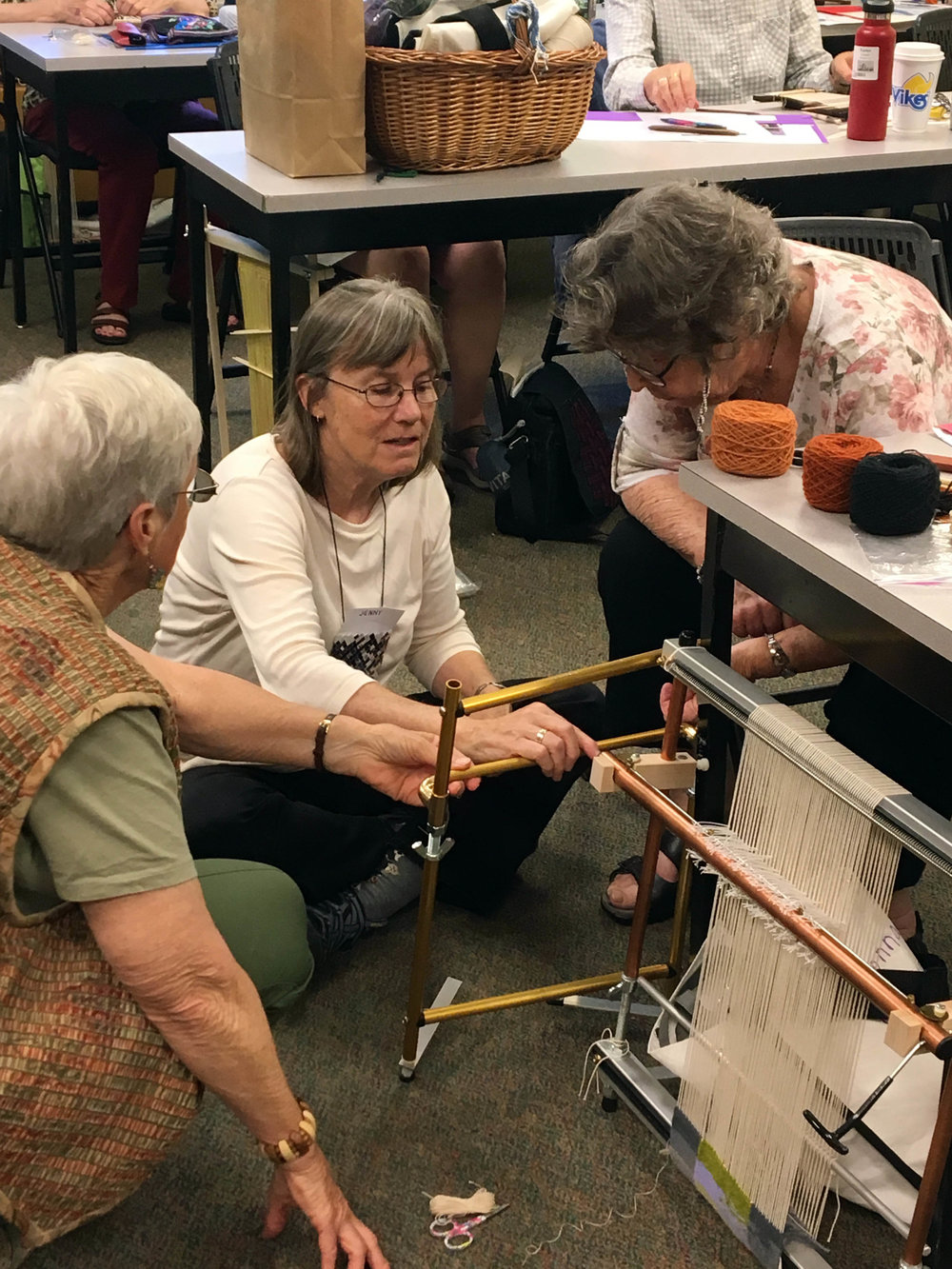 Jeanelle, Jenny,and Donna discussing looms.