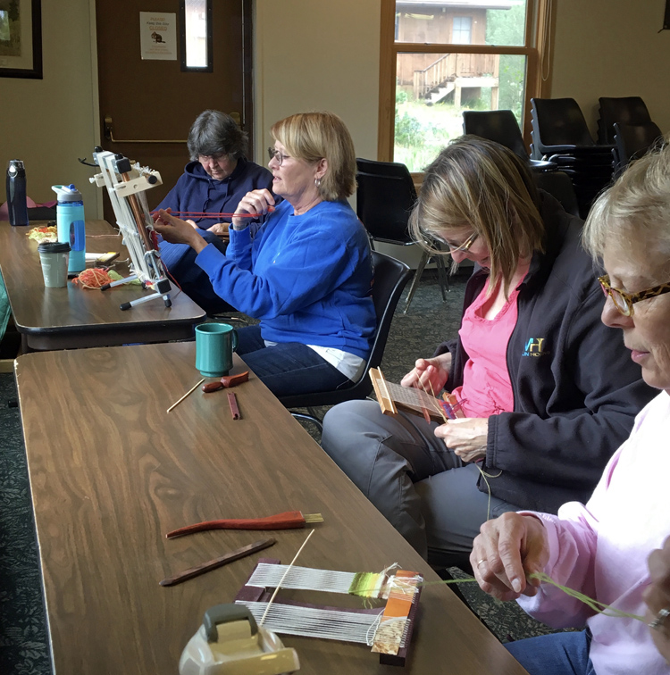 Ute, Marilyn S., Carol, and Cynthie weaving