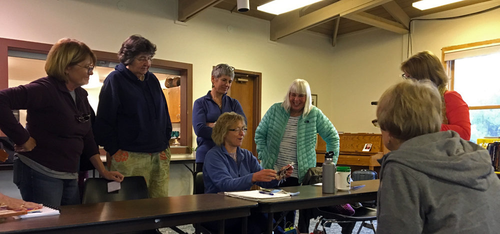 Retreat review: Mar, Ute, Paula, Marilyn, Leslie, Cynthie, and Jane is sitting.