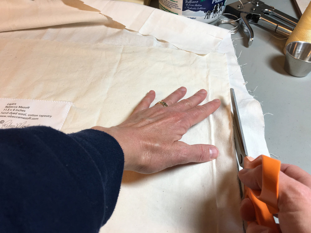 Cut each layer of fabric to the same size