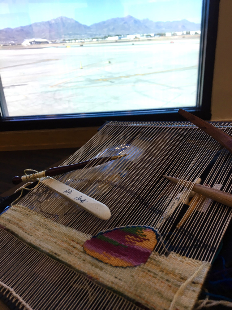 Airport weaving in El Paso. Lighter colored variegated yarn is from Quillin Fiber Arts in Las Cruces.