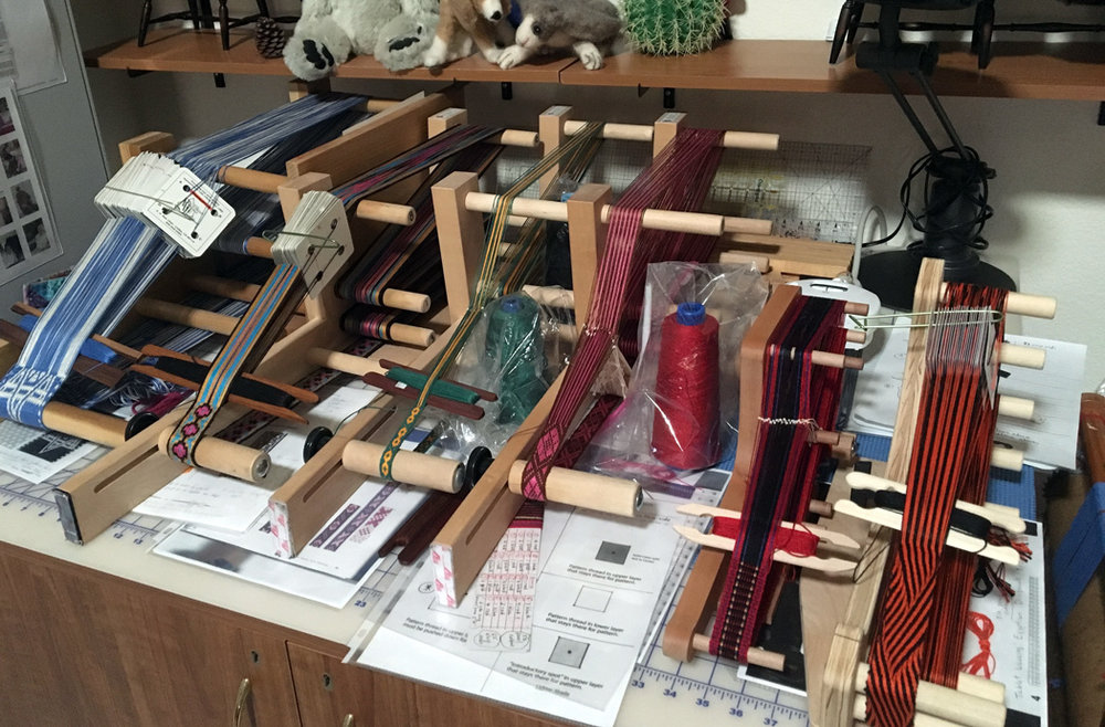 Tablet weavings by Maurine Adrezin.