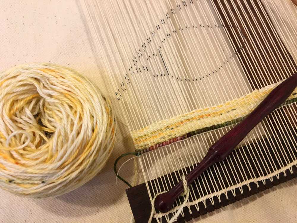 Holiday weaving on Hokett loom with yarn by Quillin Fiber Art. Bobbin by Milissa Ellison Dewey (Bobbin Boy)
