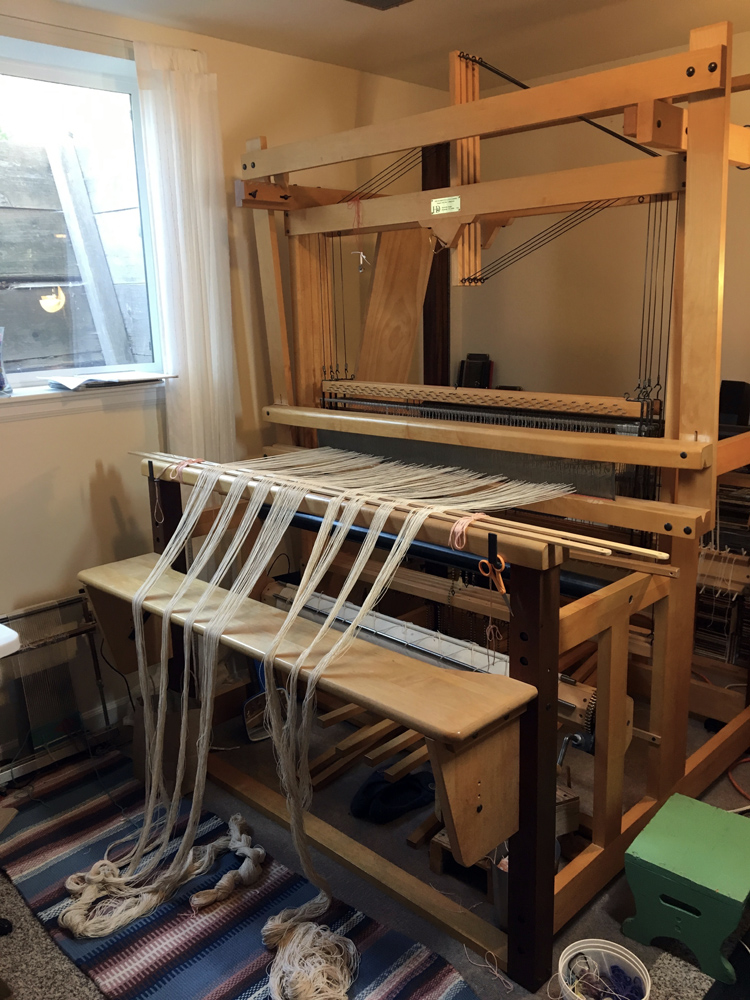 Rebecca Mezoff, warp going on the Harrisville Rug Loom for a large commission