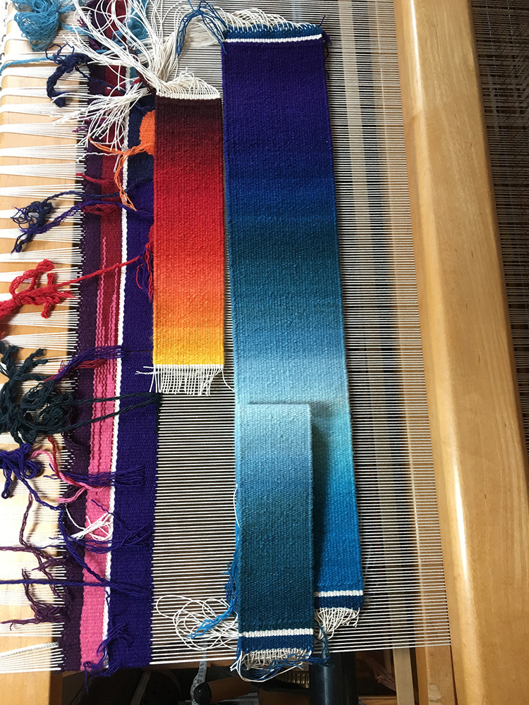 Rebecca Mezoff, woven samples for current commission. You can see that I had two ideas for the bottom teal color--the one underneath is brighter and I rejected it for various reasons. Remember that that teal to purple gradation will be stretched to nine feet!