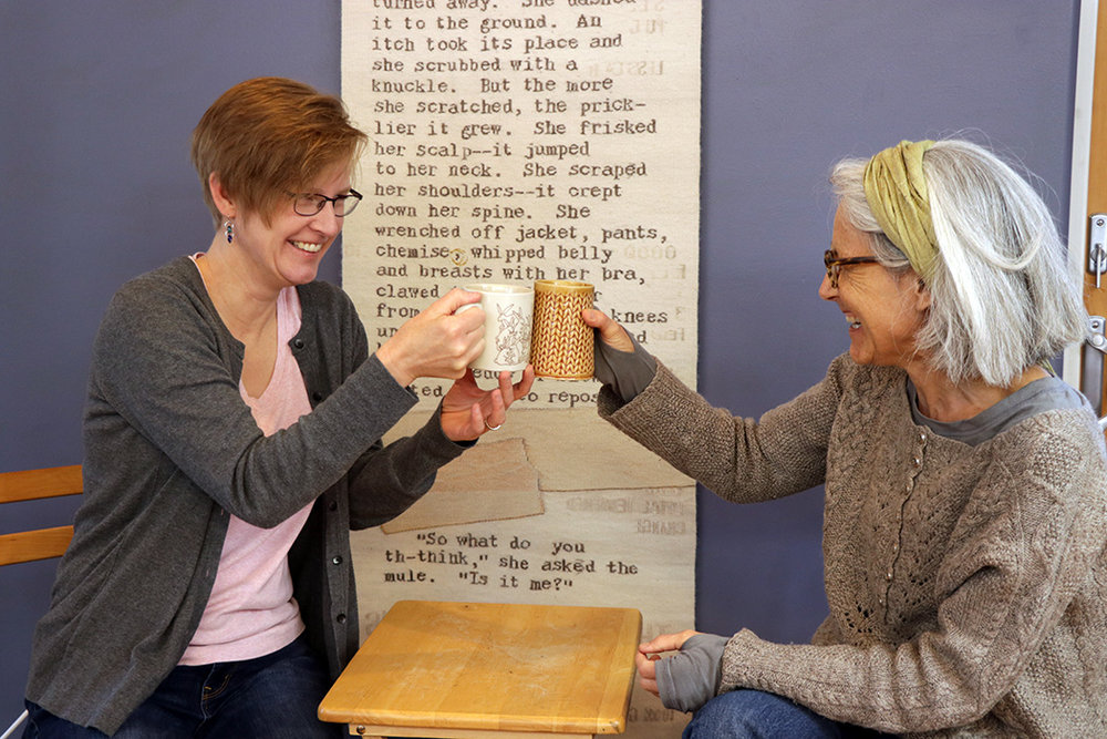 Rebecca Mezoff and Sarah Swett toasting James Koehler, March 4, 2018. Tapestry is Sarah Swett's Rough Copy #4.
