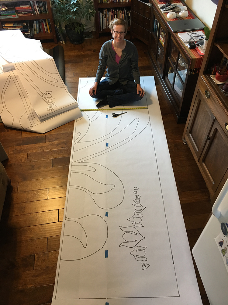 Rebecca Mezoff tracing the cartoon for a large commission onto acetate.