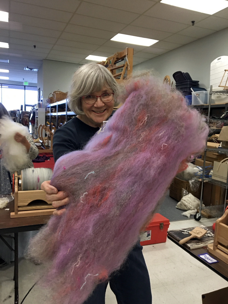 Maggie Casey, owner of  Shuttles, Spindles, and Skeins  in Boulder,  CO showing us a batt from a drum carder class. She is not fond of those yarn additions and I'd be willing to bet if she spun this, she'd pick them out!