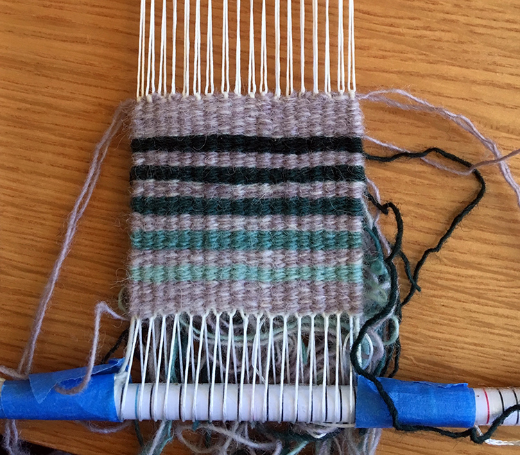 Four selvedge on Brown Sheep warp. That lavender background color is the SAME throughout! 8 epi.