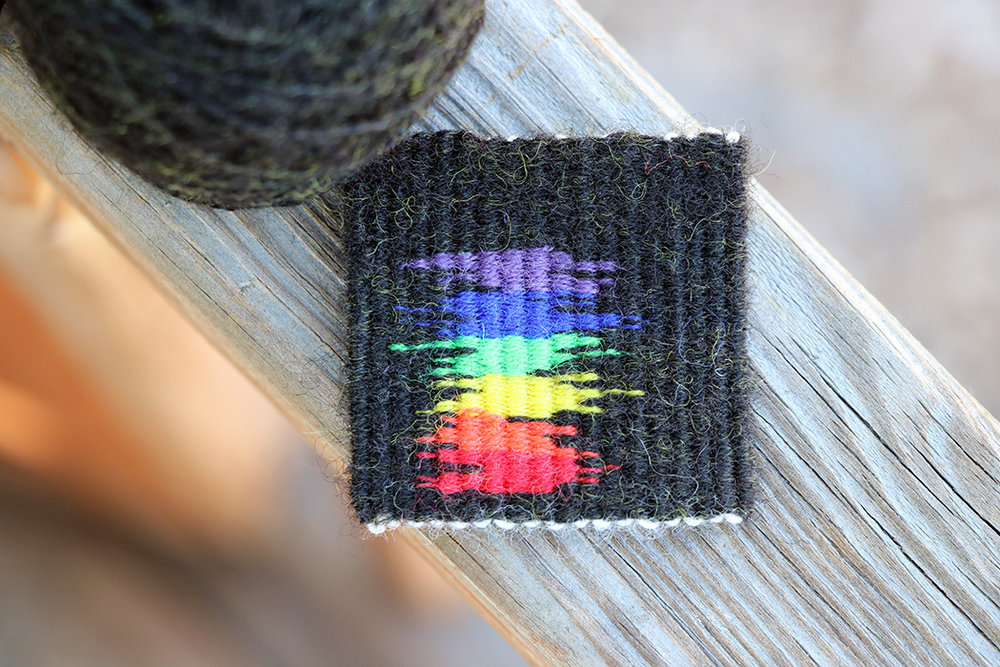 Rebecca Mezoff,  Redacted: Pride,  2 x 2 inches, four selvedge tapestry technique
