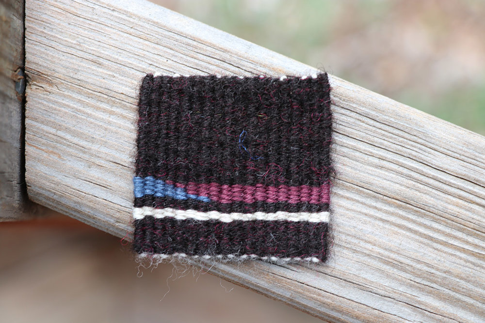 Rebecca Mezoff, handspun black CVM drum carded with a little bit of bright pink Corriedale, hemp yarn, wool warp, 2 x 2 inches