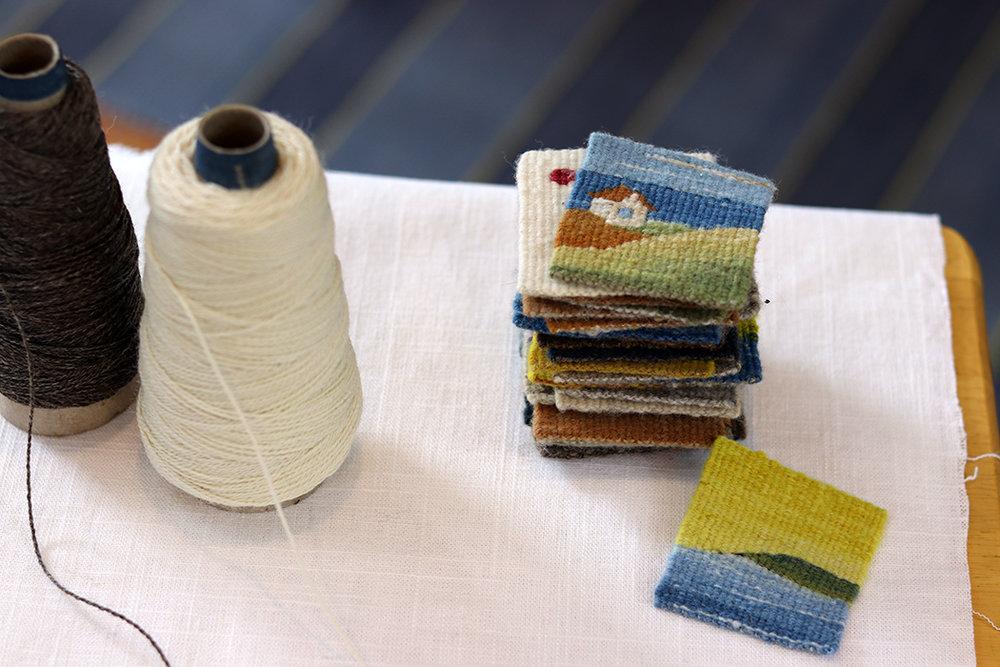Sarah Swett, stack of tiny house four selvedge tapestries