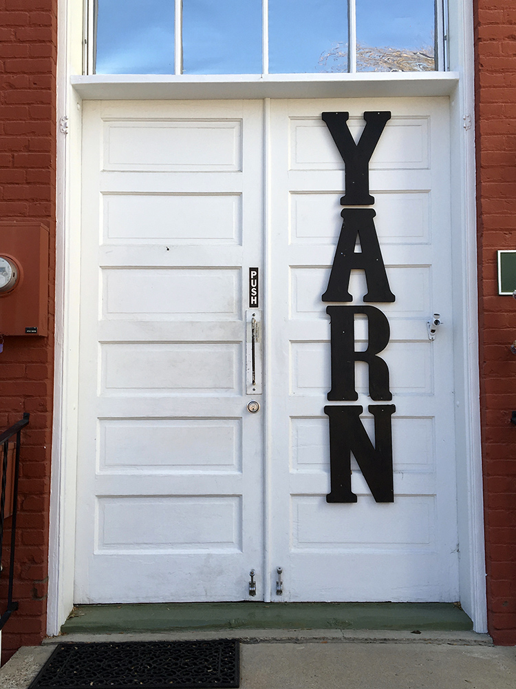 I'm good at finding the back doors into things. This is the back door to a treasure chest of yarn.  Longmont Yarn Shoppe.