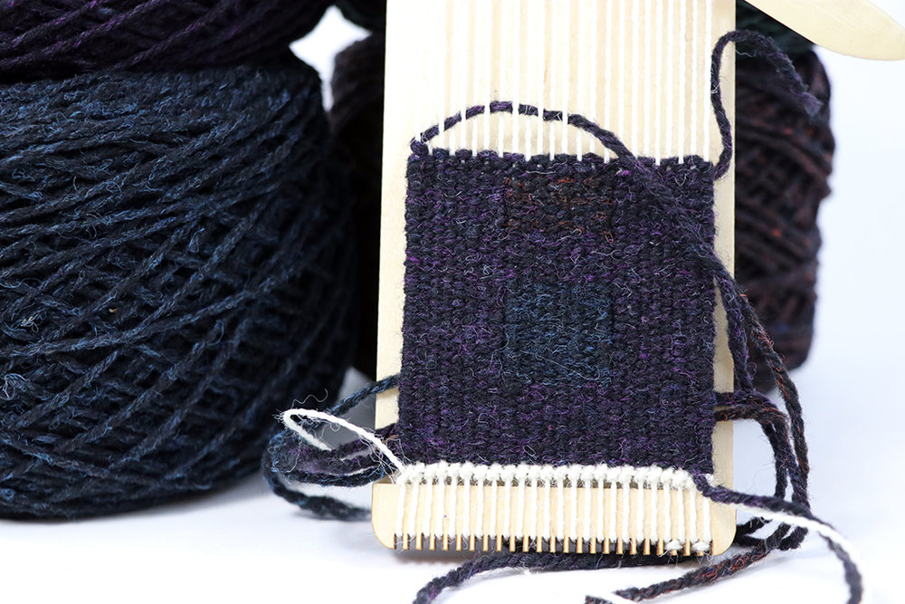 Nightshades yarn woven on a Purl and Loop bracelet loom. This combination was significantly difficult to handle. It may look fairly good, but it wasn't easy! Note the three different colors of Nightshades used here.