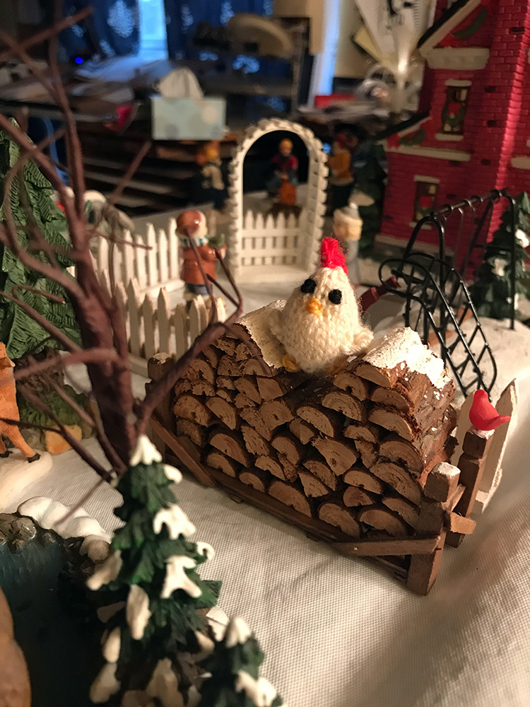 Chicken in a Detroit Christmas Village wood pile.