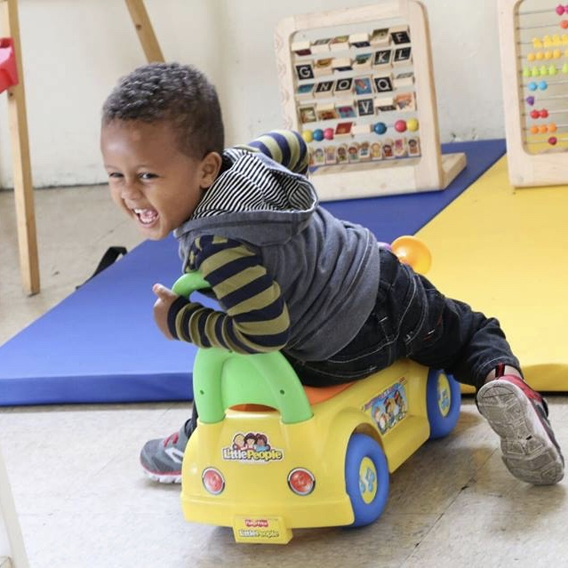 little boy on a car square.jpeg