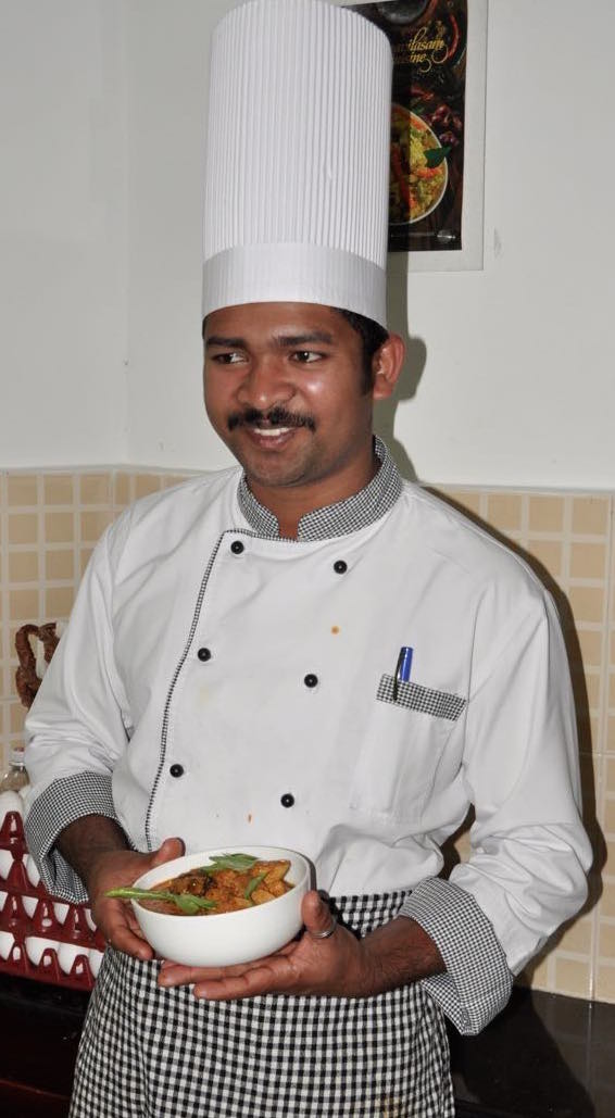 Chef Anish with his delicious fish curry