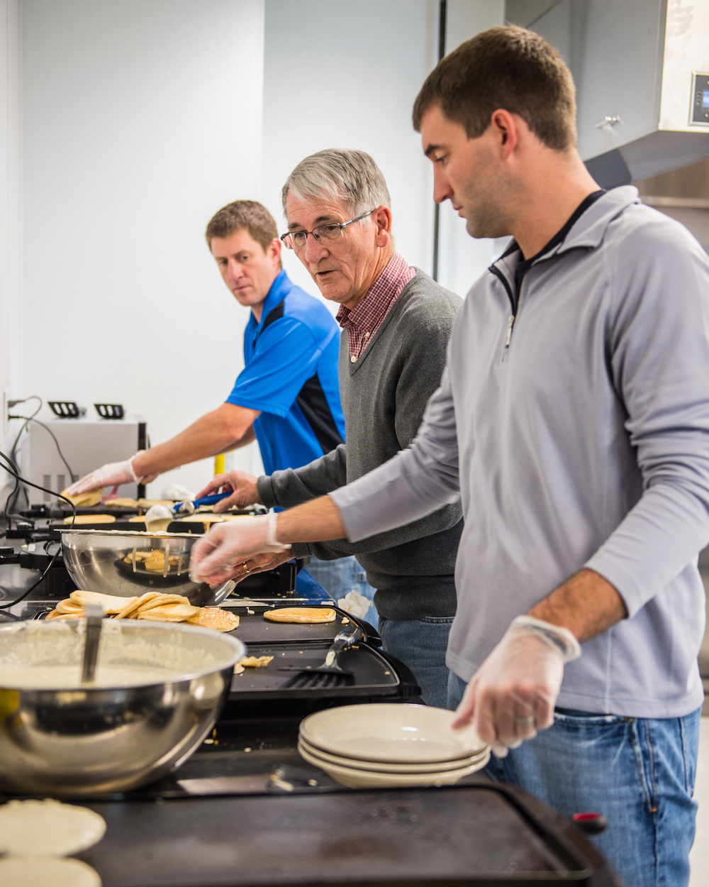 Knights prepare pancakes in the kitchen.