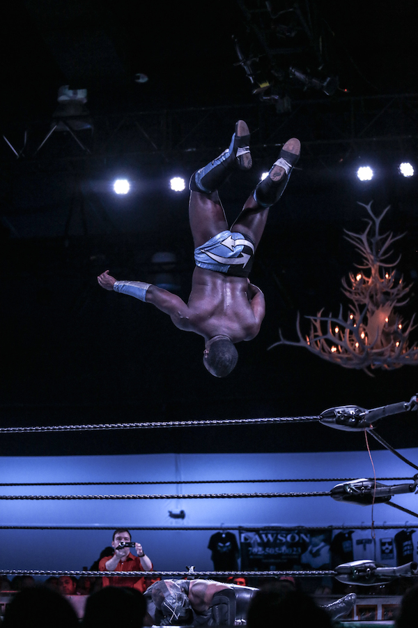 An independent wrestler in Las Vegas launches into the air for a moonsault.