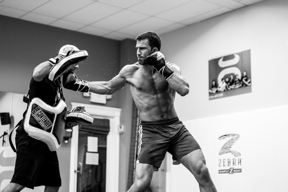 Luke Rockhold working with Henri Hooft.