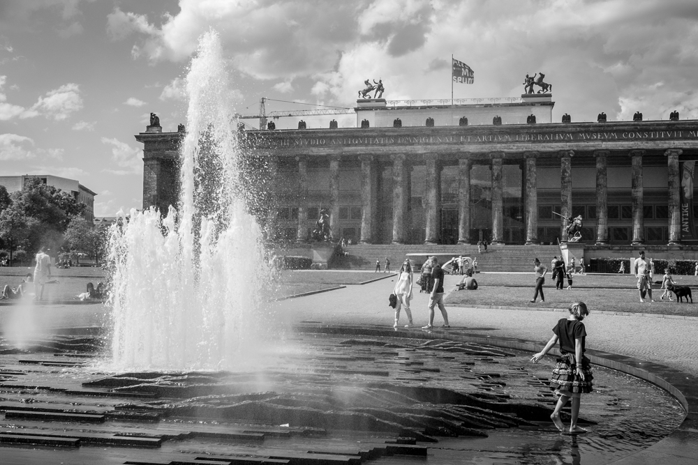 A young girl plays in a fountain in Berlin, Germany.