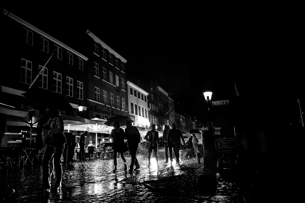People caught in a rainstorm in Copenhagen, Denmark.