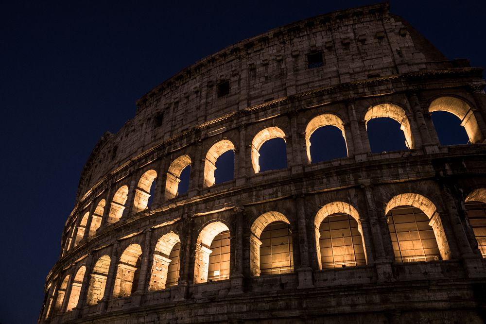The Colosseum lit up in Rome, Italy.