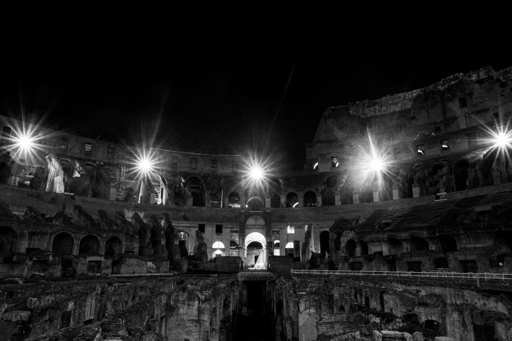 All alone inside the Colosseum at night in Rome, Italy.