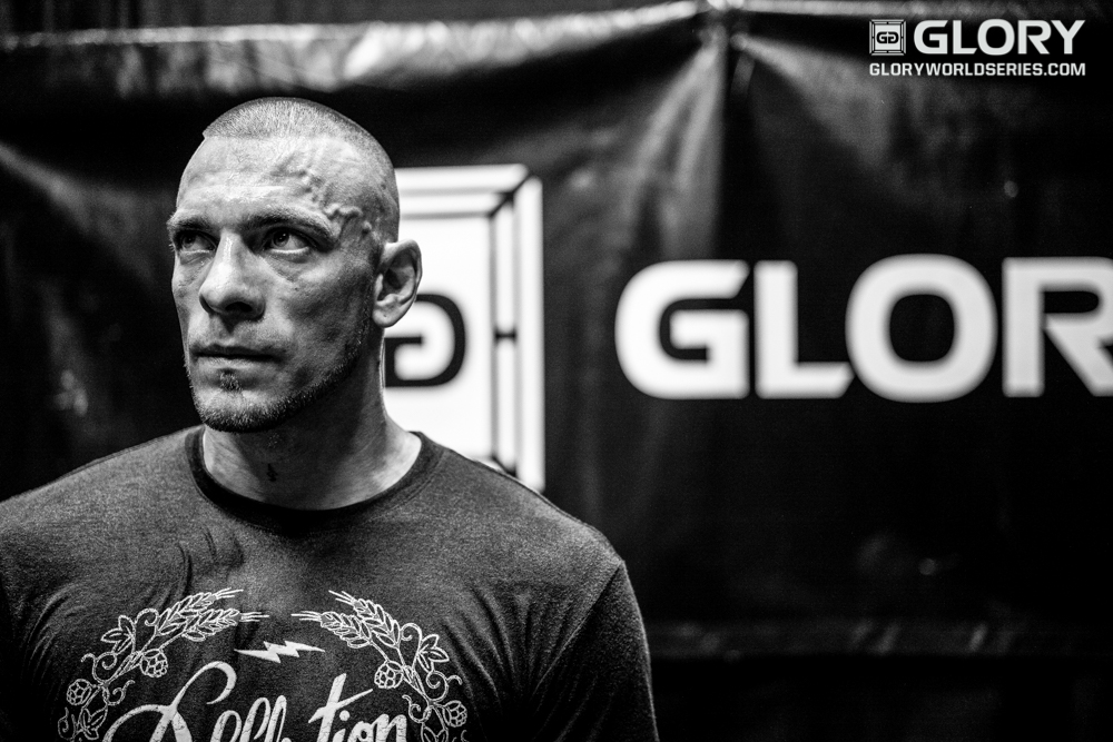 Joe Schilling watches the action backstage before his name is called to walk.
