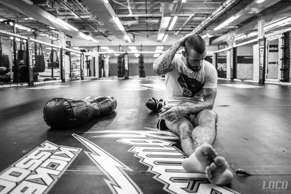 UFC fighter and former WWE superstar CM Punk takes a moment to himself after a training session at Roufusport Gym in Milwaukee.