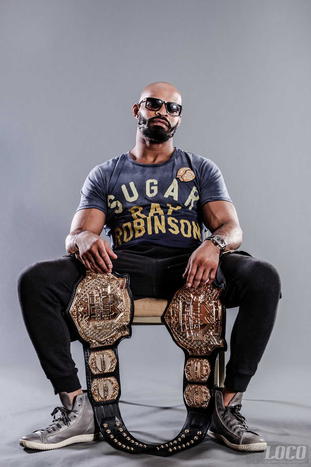 Two weight champion David Branch poses with his WSOF title belts in Kansas City.
