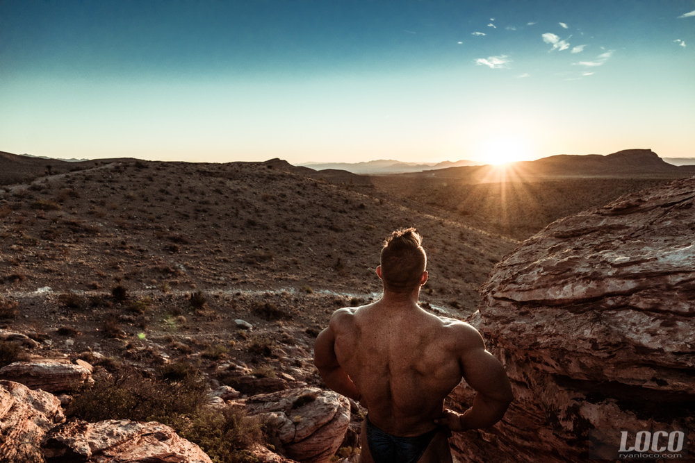 The 5 time Mr. Olympia 212 champion Flex Lewis looks out at the sunrise over Red Rock Canyon.