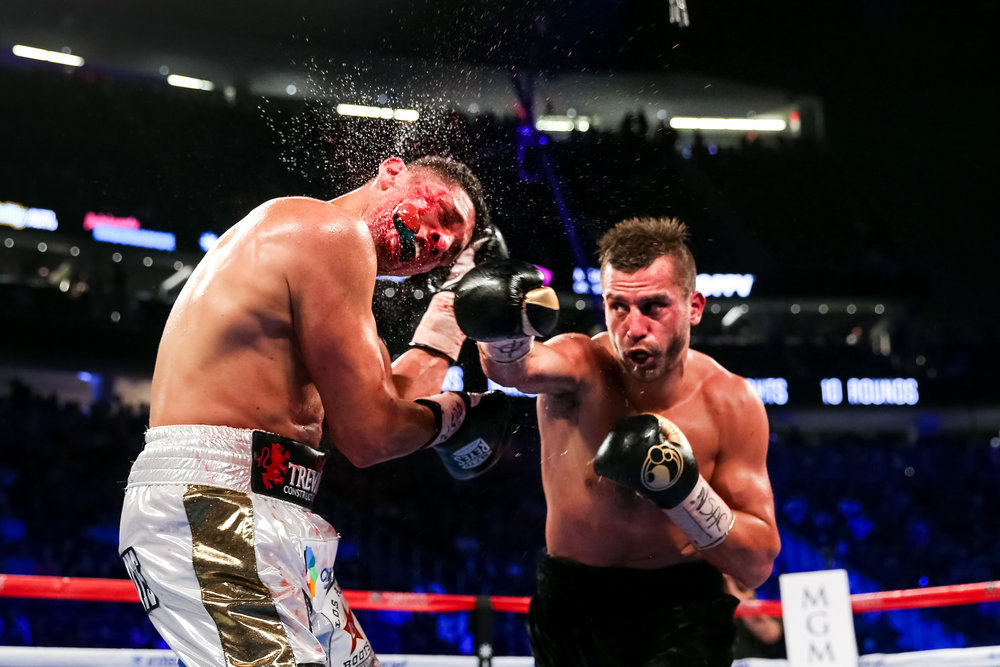 David Lemieux removes the mouthpiece of Marcos Reyes on the undercard of Canelo v Chavez Jr