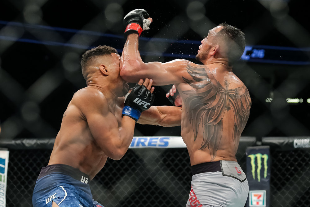 Tony Ferguson lands a big elbow against Kevin Lee, on his way to becoming the interim UFC lightweight champion.