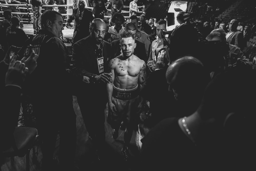 A defeated Carl Frampton leaves the ring after his fight against Leo Santa Cruz.