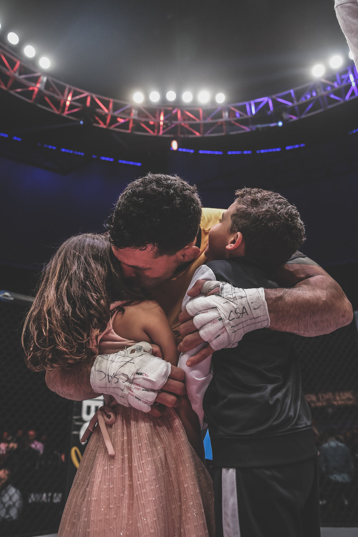 Vinny Magalhaes hugs his children post PFL victory in Long Beach, CA.