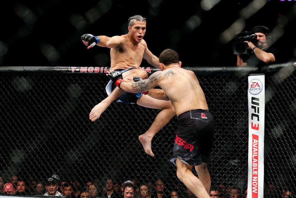 Brian Ortega goes airborne against Frankie Edgar. Las Vegas, NV.
