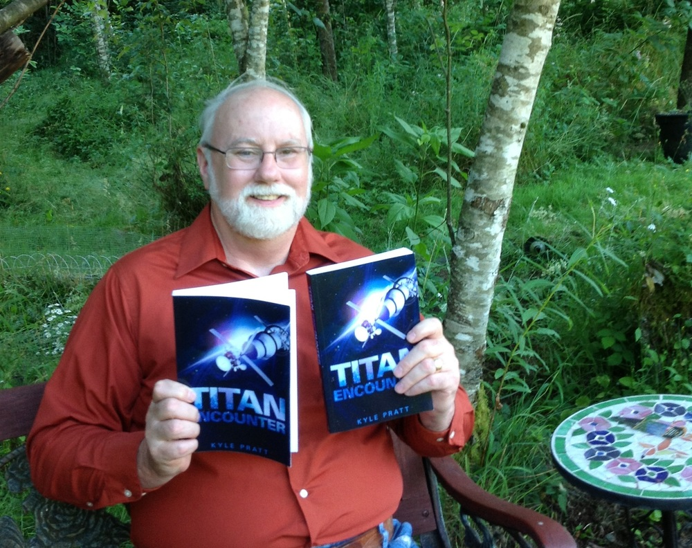 Kyle Pratt with the first paperback copies of Titan Encounter