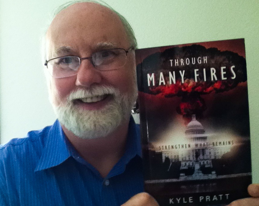 Kyle Pratt with the first copy of Through Many Fires