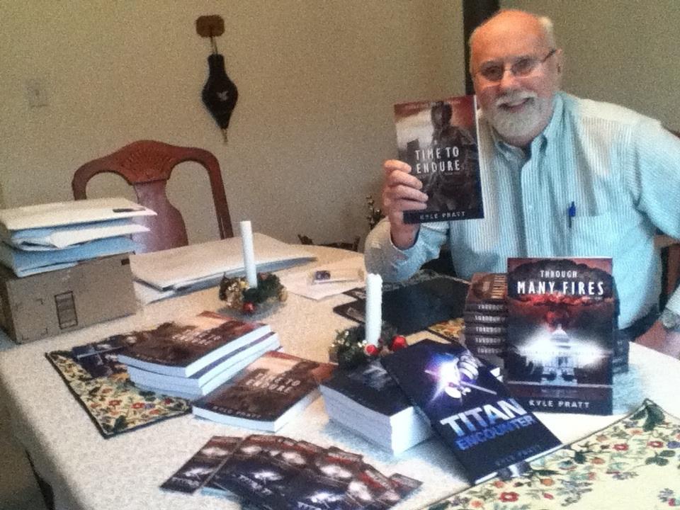 Kyle Pratt signing books