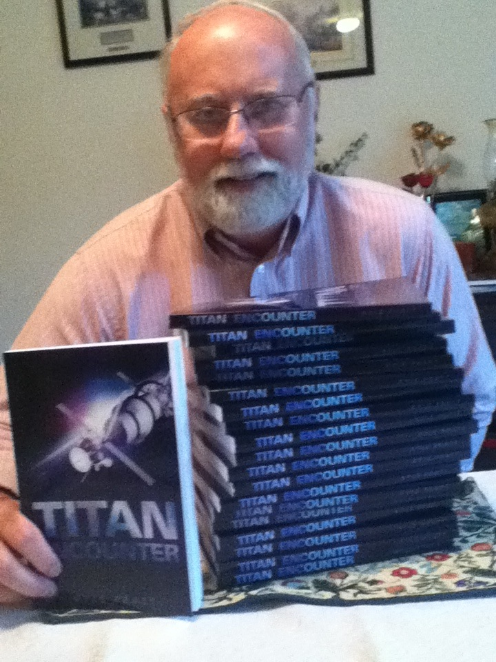 Kyle Pratt with copies of Titan Encounter