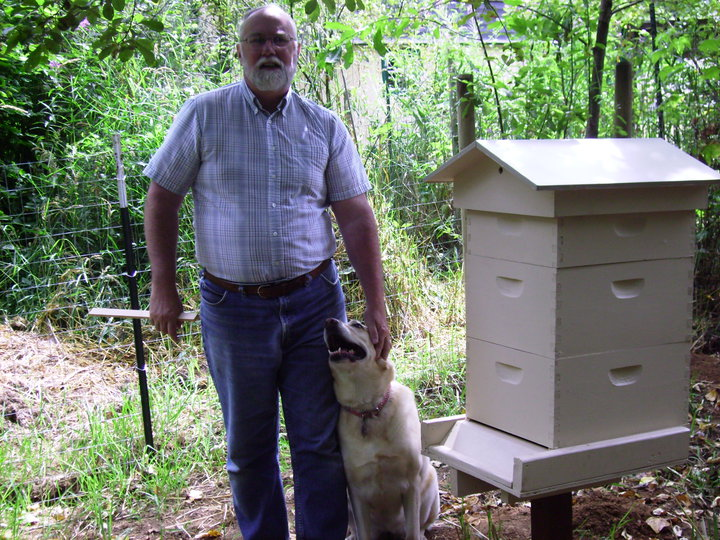 Kyle Pratt, his dog Nikki and the new hive boxes