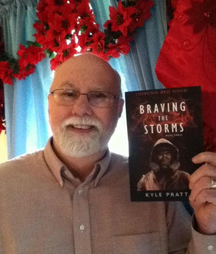 Kyle Pratt with the proof copy of Braving the Storms