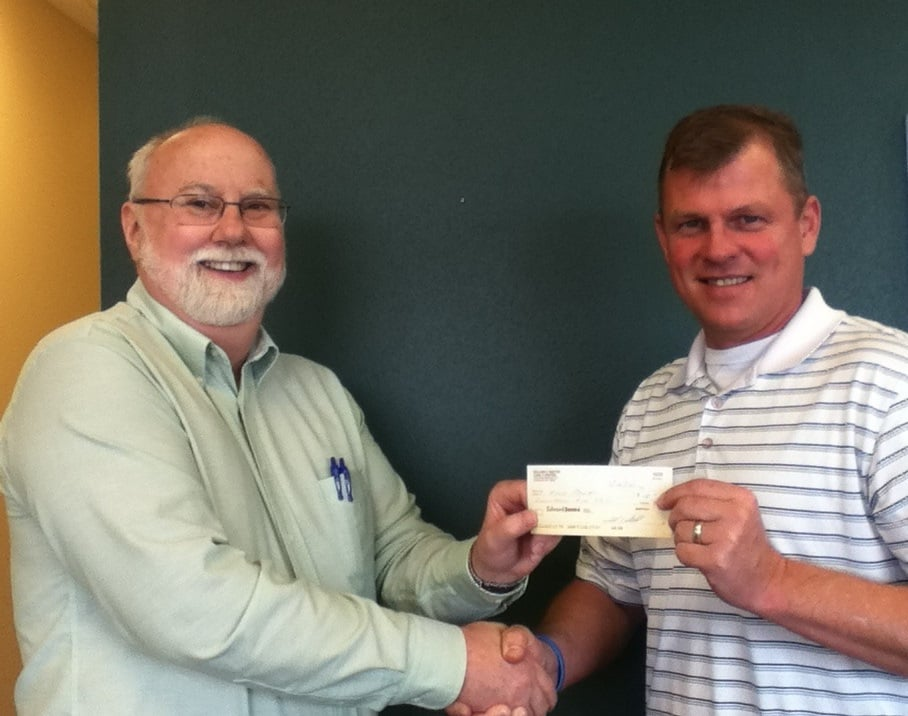 Kyle Pratt and Bill Radtke on March 20, 2015 with a check for the unnamed third book.