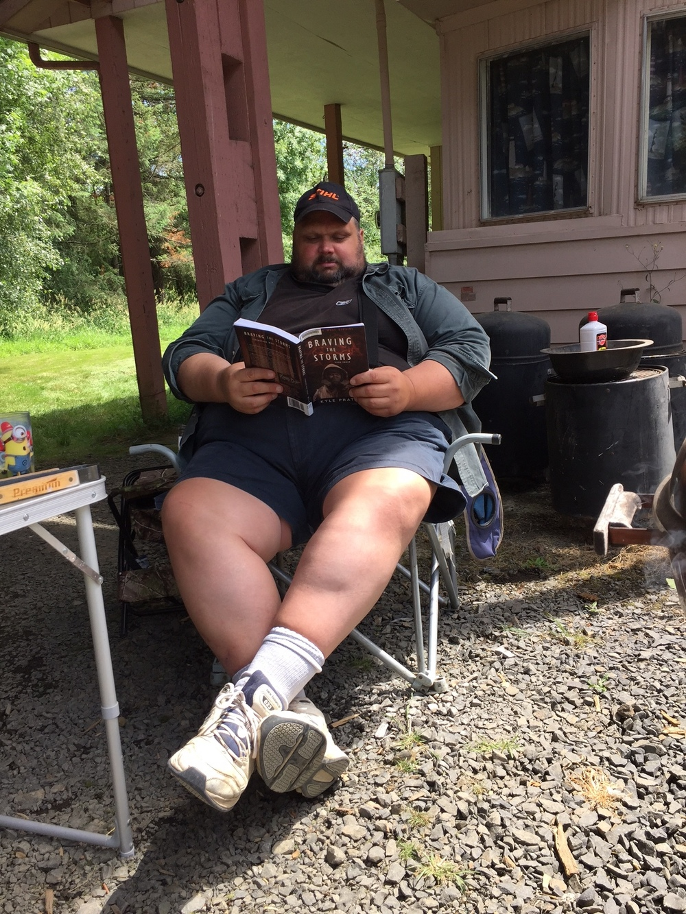 Chris in Napavine, Washington State, reads  Through Many Fires  while the barbecue warms up.