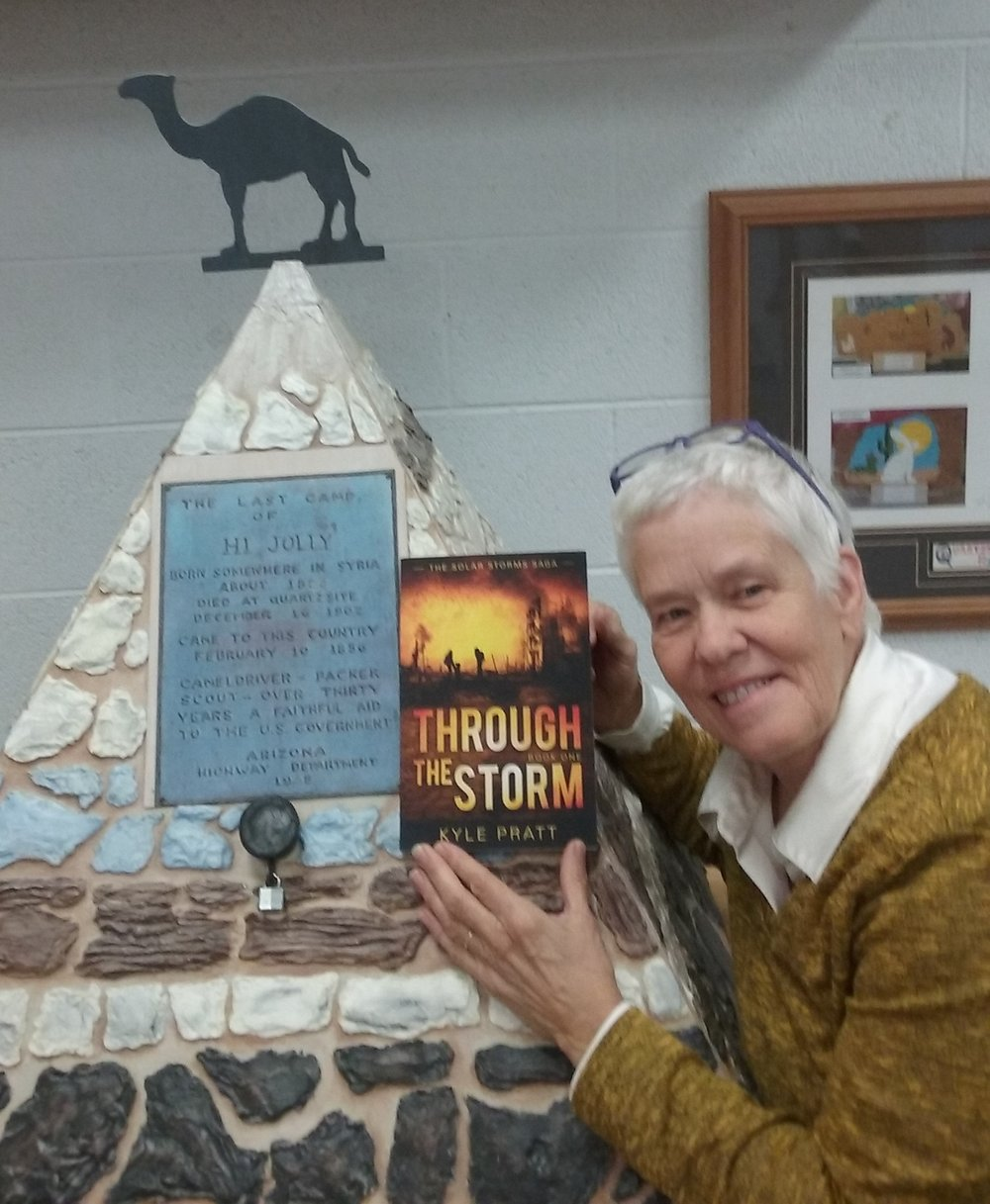 Joyce in Quartzsite, Arizona with a copy of Through the Storm.