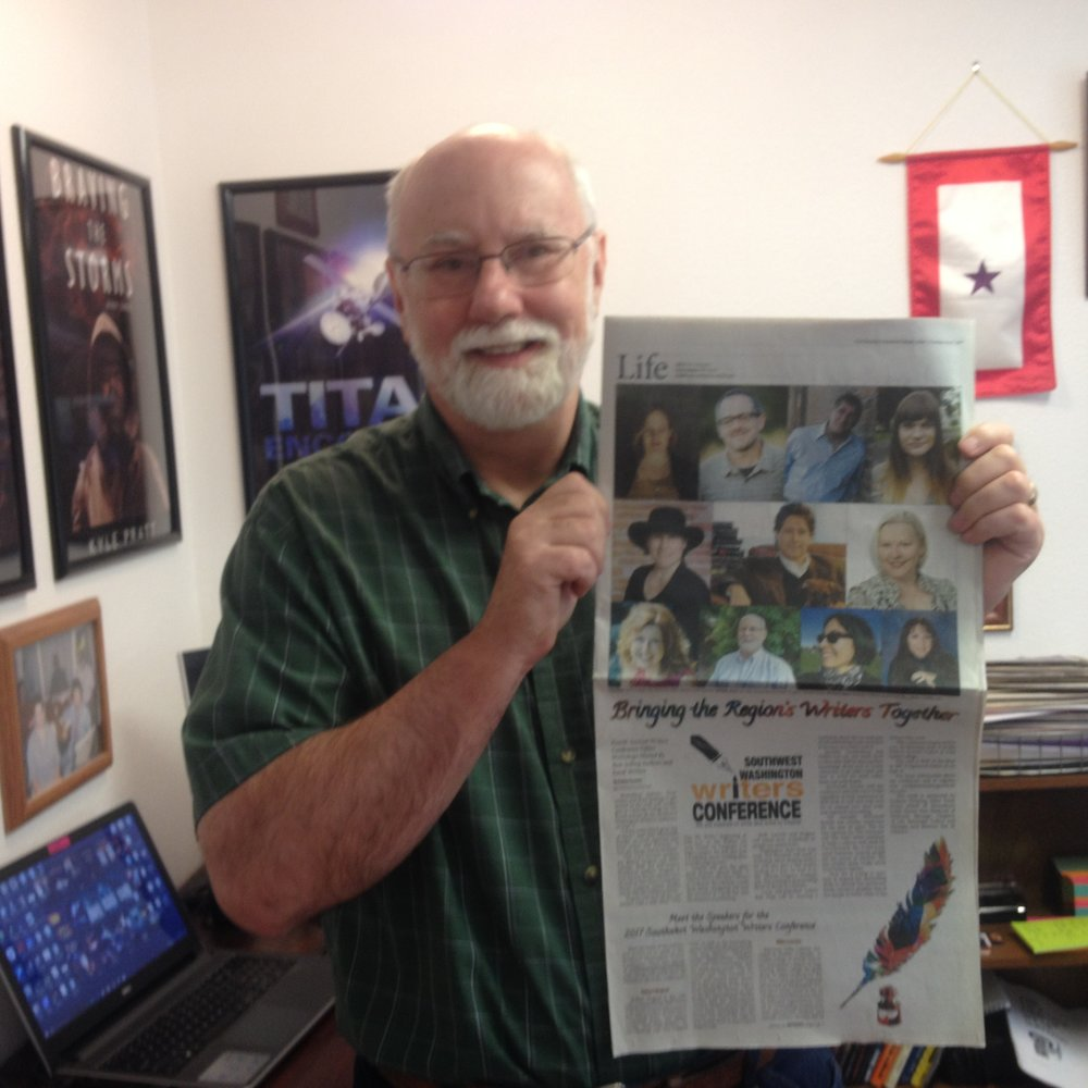 Kyle with Newspaper August 31, 2017.JPG