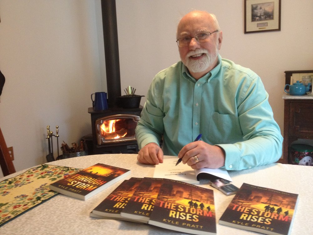 Kyle with copies of The Storm Rises.JPG