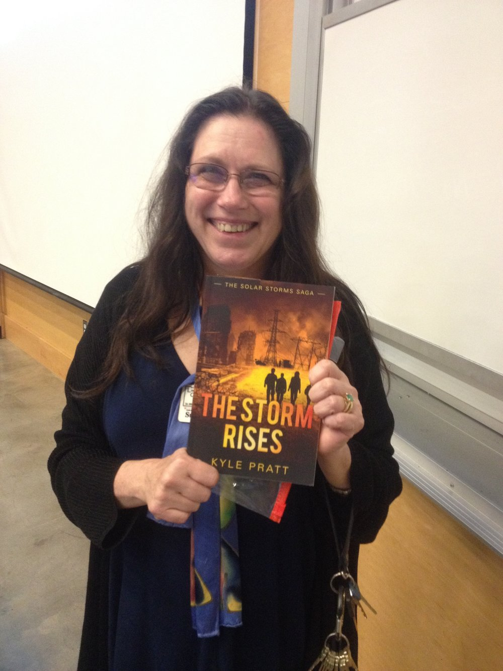Susanne from Centralia, Washington State holds a copy of The Storm Rises.